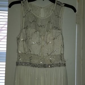 White sequin lace mini dress with sheer cover